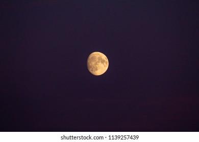 Orange Moon in a Dark Purple Sky