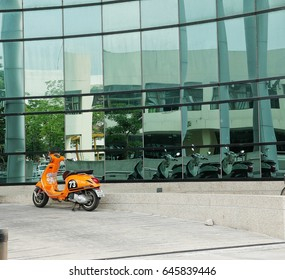 Orange motercycle but mirrored in become white motercycle May 22, 2017 Bangkok.