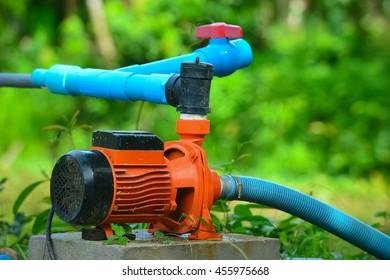orange motor water pump in the garden