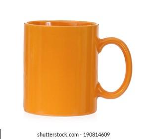 Orange mug for coffee or tea, isolated on white background