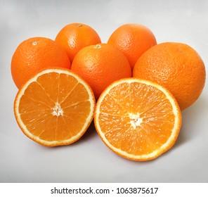 orange navel 5 pieces on grey background