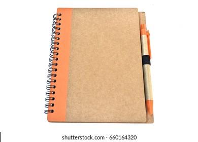 Orange notebook and writing pen on white background