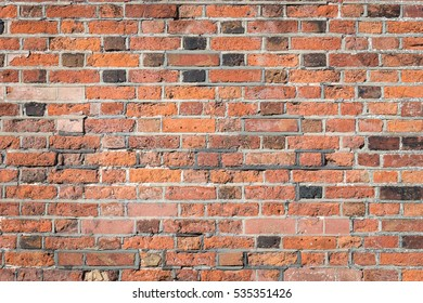 Orange old brick on wall texture background