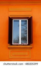 Orange with Open Shutters Window