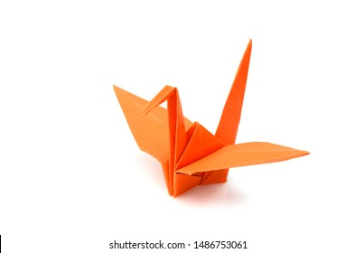 Orange origami Crane on a white background