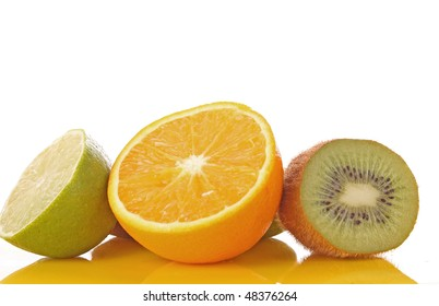 Orange and other fruits on yellow