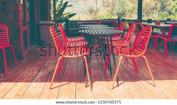 Terrific Orange Outdoor Table Chairs Bistro Daytime Stock Photo Edit Cjindustries Chair Design For Home Cjindustriesco