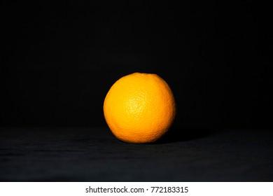 orange over black background