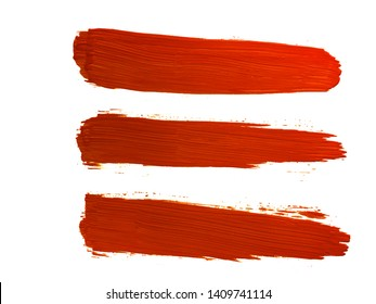 orange paint or ink brush strokes on white background