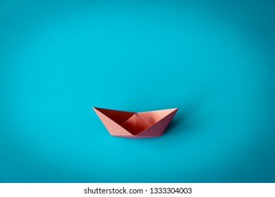 orange paper boat on bright background with copy space, learning and education concept