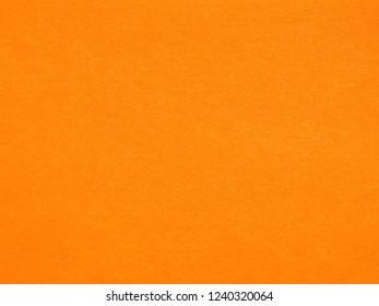 Orange paper texture useful as a background, soft pastel colour