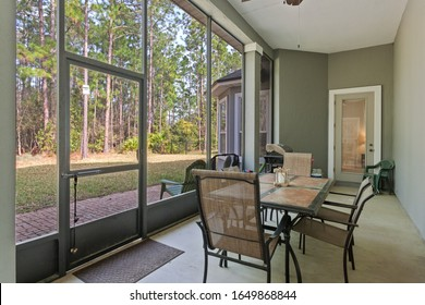 Orange Park, Florida / USA - February 19 2020: Screened in patio with a table and chairs and a nice view