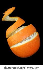 Orange and peel curling upwards against black