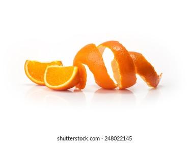 Orange peel and orange wedge on white background