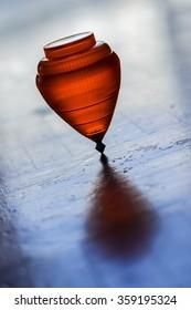 orange peg-top spinning