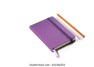 Orange pencil and purple notebook isolated on white background