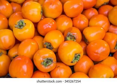 Orange persimmon kaki fruits freshly