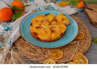 orange pie on blue plate with dried orange