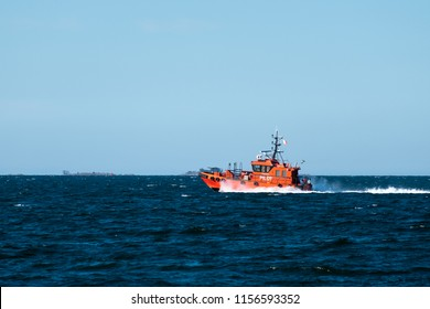 Orange Pilot Boat at Speed