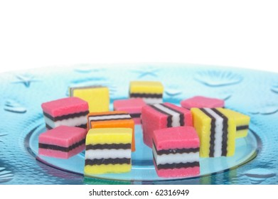 orange pink and yellow licorice on plate