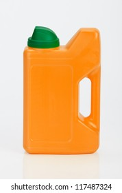 Orange plastic bottle on white