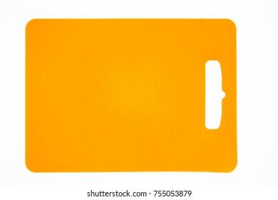 Orange plastic cutting board isolated on white background