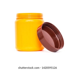 Orange plastic jar with a lid on a white background, isolate, tara