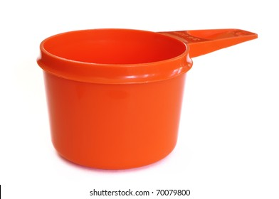 Orange Plastic Measuring Cup Isolated on a White Background
