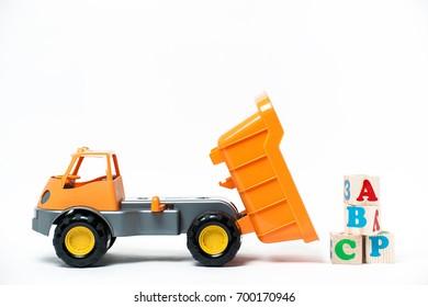 Orange plastic toy truck isolated on white background