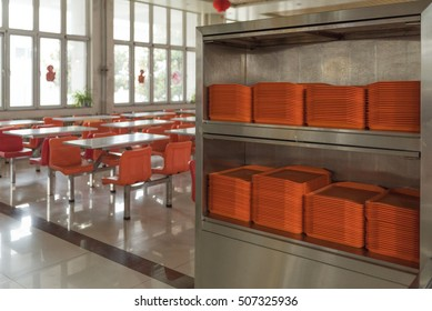 orange plates in mess hall