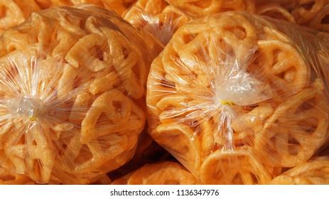 Orange pork rinds bagged for retail sales