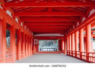 A orange posted walkway in Itsukushima shrine.