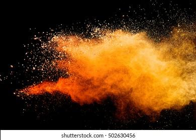 Orange powder isolated on black background