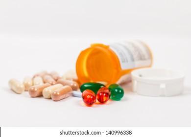Orange Prescription Medication Bottle with Pills