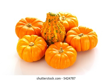 Orange pumpkins with a textured orange gourd in the middle.