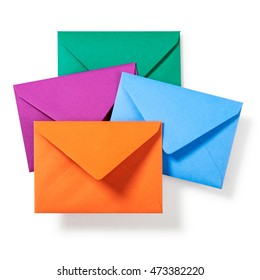 Orange, purple, green and blue envelopes on white background, clipping path included. Autumn colors. Top view, flat lay
