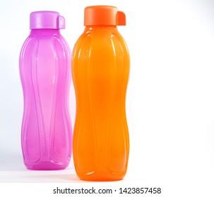Orange and Purple Tupperware Water Bottles