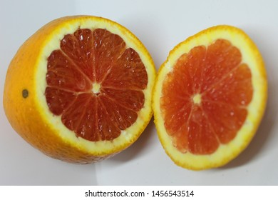 orange with red interior, Cara Cara type, most found in the Americas and great anti oxidant