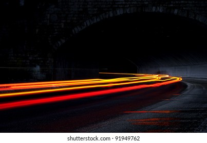 Orange and red lights in a tunnel