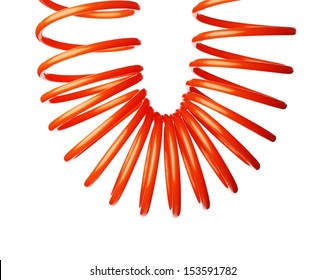 Orange red thin spiral air hose used for pneumatic tools.