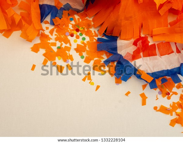 Orange, red, white and blue decorations for Kings day in the Netherlands. Top view with room for copy.