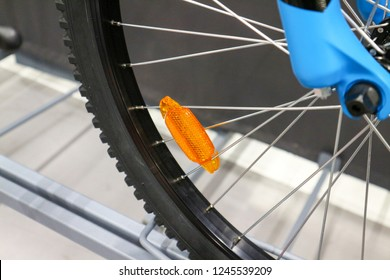 Orange reflectors on bike wheels.Selective focus