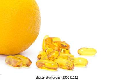Orange refreshment and supplementary food (Fish oil)  on white background. It's easy to work with these professionally retouched high quality image.
