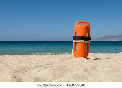 Orange rescue buoy on the beach