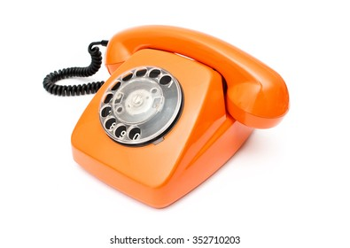 Orange retro telephone isolated on white background