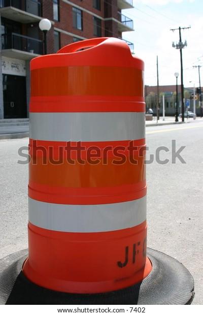 orange road marker in the street