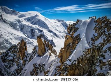 Orange Rocks Among Mountains