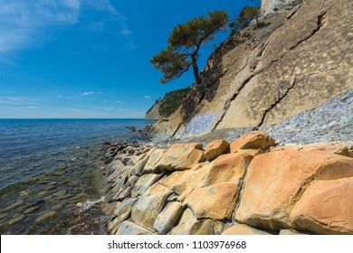 Orange rocks located on the Black Sea coast. Gelendzhik district, Krasnodar region, Russia.