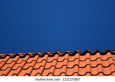 Orange roof with blue sky