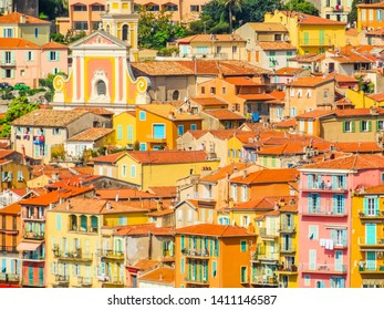 Orange roofs, old houses, church and bell tower of the Mediterranean city. Aerial view of the Villefranche-sur-Mer, France